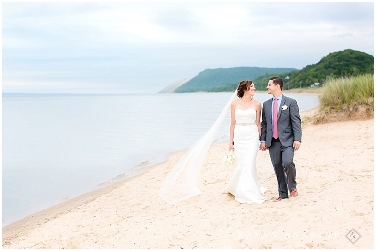 Bride And Groom Walking The S Of Lake Michigan After Their Wedding