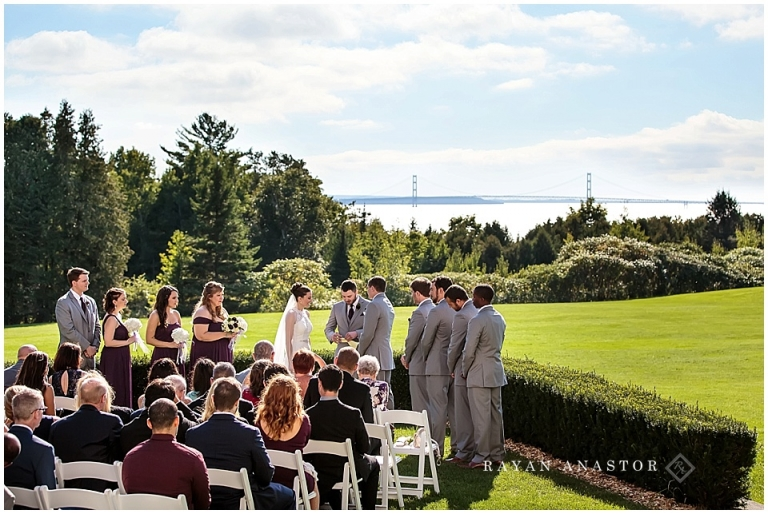 wedding on the lawn at the inn at stonecliffe overlooking the mackinac bridge