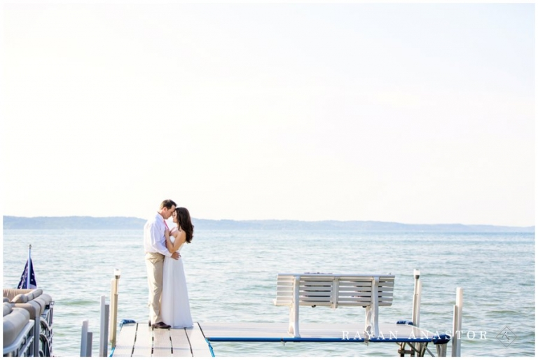 Bride And Groom On Dock Overlooking Torch Lake